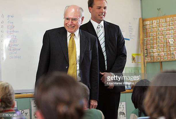 Prime Minister John Howard and member for Dickson Peter Dutton tour a classroom during a visit to Our Lady of the Way primary school in Petrie on...