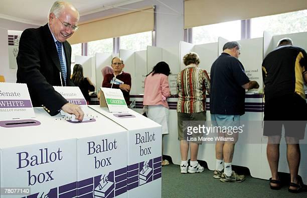 Prime Minister John Howard casts his vote at Ermington Primary School on November 24 2007 in Sydney Australia More than 135 millions Australians are...
