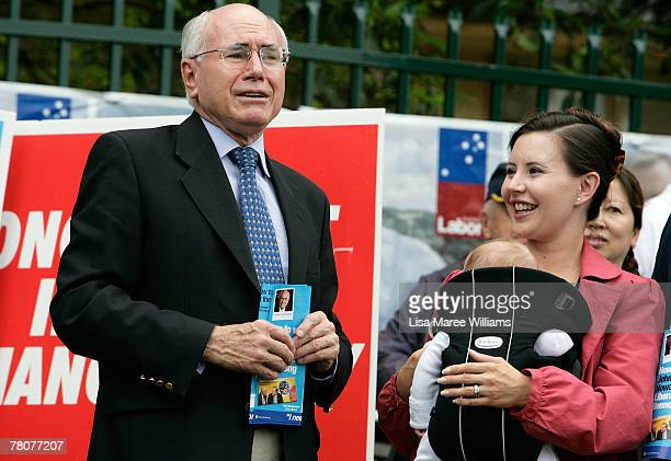 Prime Minister John Howard is greeted by daughter Melanie HowardMcDonald and grandson Angus at Ermington Primary School on November 24 2007 in Sydney...