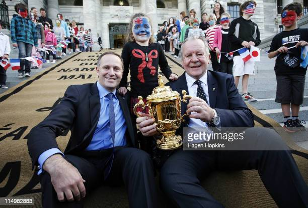 Prime Minister John Key and IRB Deputy Chairman Bill Beaumont hold the Webb Ellis Trophy with Ariana Dick age 8 during celebrations to mark 100 days...