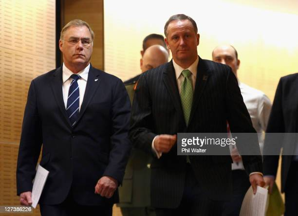 Prime Minister John Key arrives with Defence Minister Wayne Mapp for a media conference at the Beehive Theatrette on September 28 2011 in Wellington...