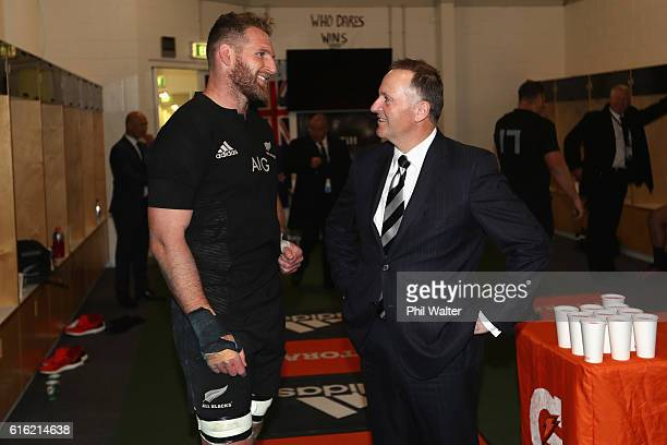 Prime Minister John Key congratulates All Black captain Kieran Read inside the dressing room during the Bledisloe Cup Rugby Championship match...