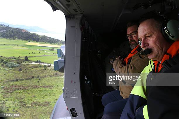 Prime Minister John Key inspects earthquake damage north of Kaikoura from an RNZAF helicopter on November 14 2016 in New Zealand The 75 magnitude...