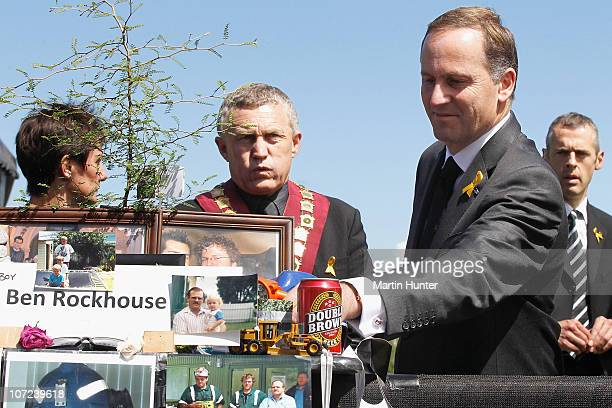 Prime Minister John Key lays a fern on a table at a national memorial service for the 29 miners that lost their lives in the Pike River Mine at Omoto...