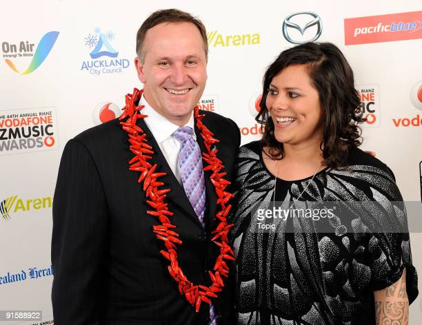 Prime Minister John Key of New Zeeland and Anika Moa pose during the 2009 Vodafone Music Awards at Vector Arena on October 8, 2009 in Auckland, New...