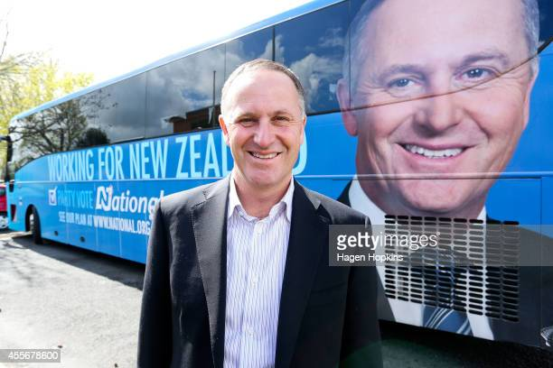 Prime Minister John Key poses outside his campaign bus during the National Party Bus Trip on September 19 2014 in Cambridge New Zealand The New...