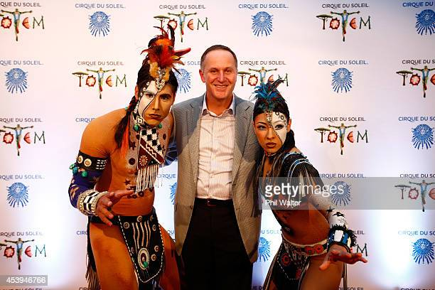Prime Minister John Key poses with performers on the opening night of TOTEM from Cirque Du Soleil at Alexandra Park on August 22 2014 in Auckland New...