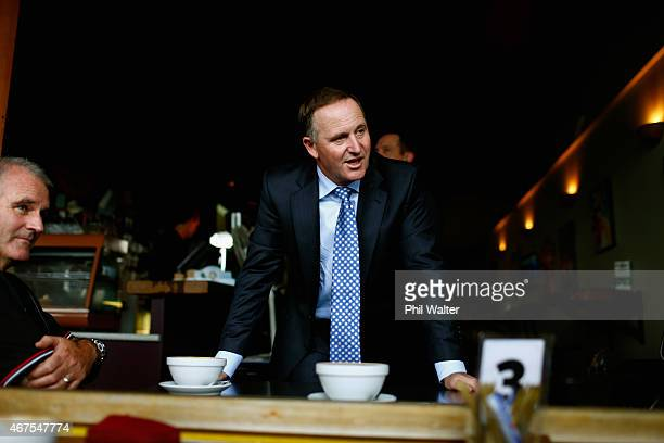 Prime Minister John Key speak with locals during a walkabout with Mark Osborne on March 26 2015 in Dargaville New Zealand The Northland byelection...