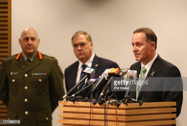 Prime Minister John Key speaks alongside Minister of Defence Wayne Mapp and Chief of Defence Force LieutenantGeneral Rhys Jones during a media...