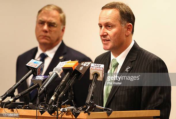 Prime Minister John Key speaks alongside Minister of Defence Wayne Mapp during a media conference at the Beehive Theatrette on September 28 2011 in...