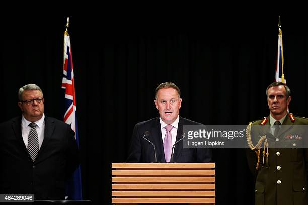 Prime Minister John Key speaks to media while Chief of Defence Force Lieutenant General Tim Keating and Defence Minister Gerry Brownlee look on...