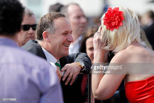 Prime Minister John Key talks to racegoers during NZ Trotting Cup Day at Addington Raceway on November 8 2011 in Christchurch New Zealand