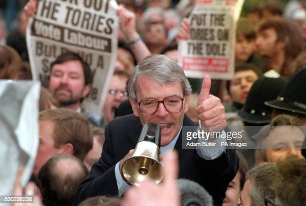Prime Minister John Major attempts to drown out jeers and abuse from hardleft activists as he takes to his soapbox during a walkabout in Luton during...