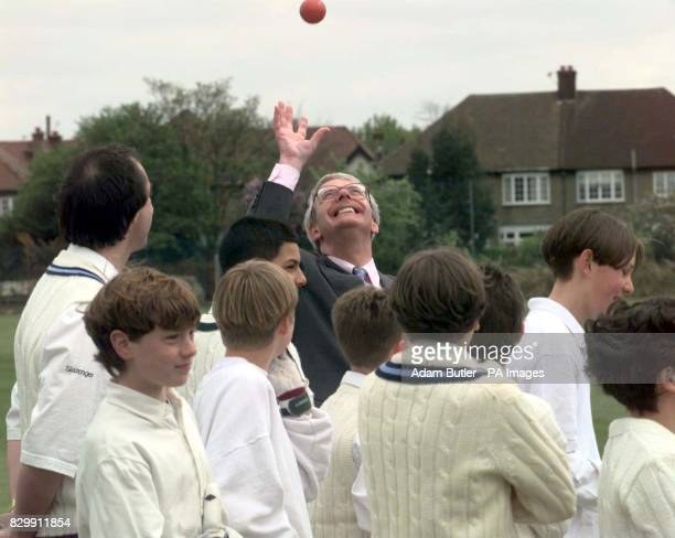 Prime Minister John Major catches a cricket ball during his visit to the Wilf Slack Memorial ground in Finchley north London this afternoon Photo by...