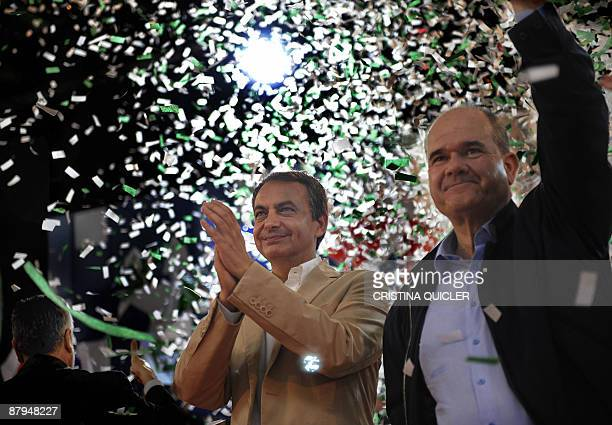 Prime Minister Jose Luis Rodriguez Zapatero and Minister of the Autonomous community of Andalusia Manuel Chaves Gonzales wave during a political...