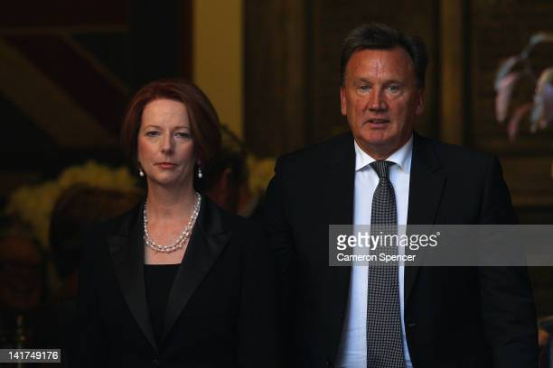 Prime Minister Julia Gillard and partner Tim Mathieson leave the memorial service for Margaret Whitlam at St James Anglican Church on March 23 2012...
