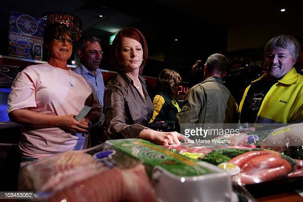Prime Minister Julia Gillard annouces the winners of a meat tray raffle at the Raymond Lakeside Tavern during the final week of campaigning ahead of...