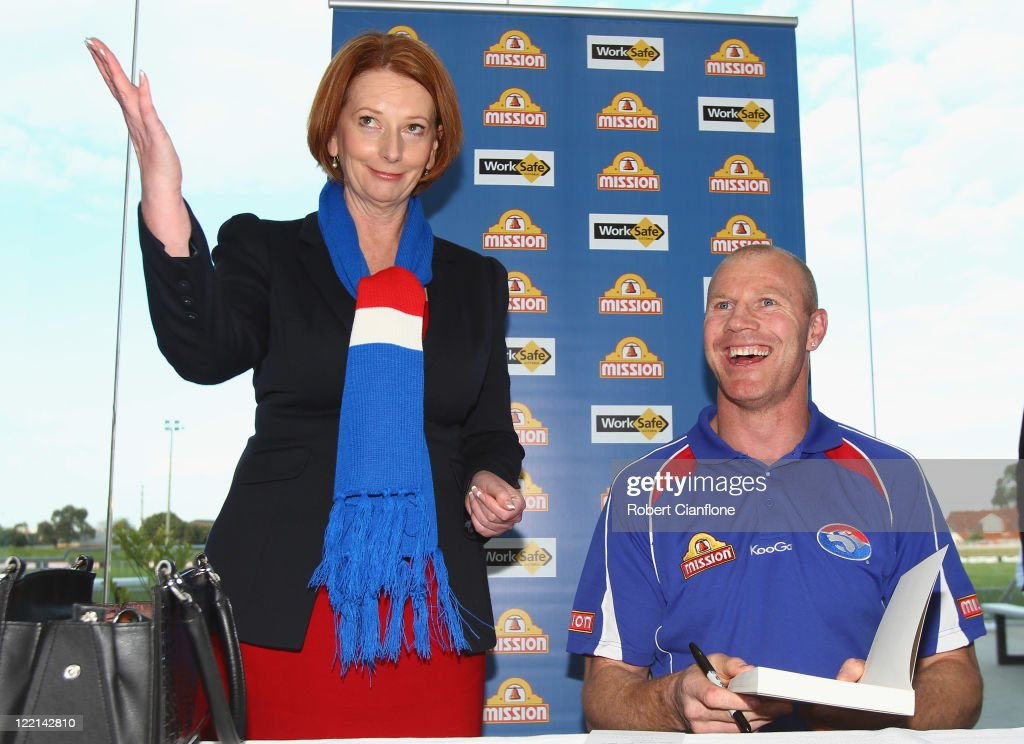 Prime Minister Julia Gillard is seen with Barry Hall at the official launch of his new book 'Pulling No Punches' at Whitten Oval on August 26, 2011 in Melbourne, Australia.