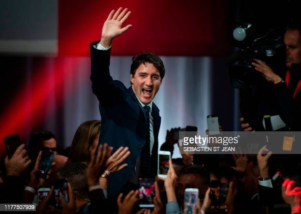 TOPSHOT Prime minister Justin Trudeau celebrates his victory with his supporters at the Palais des Congres in Montreal during Team Justin Trudeau...