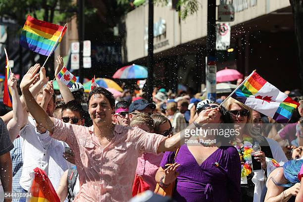TORONTO ON JULY 3 Prime Minister Justin Trudeau is soaked during the the 2016 Toronto Pride parade along Yonge Street in Toronto July 3 2016