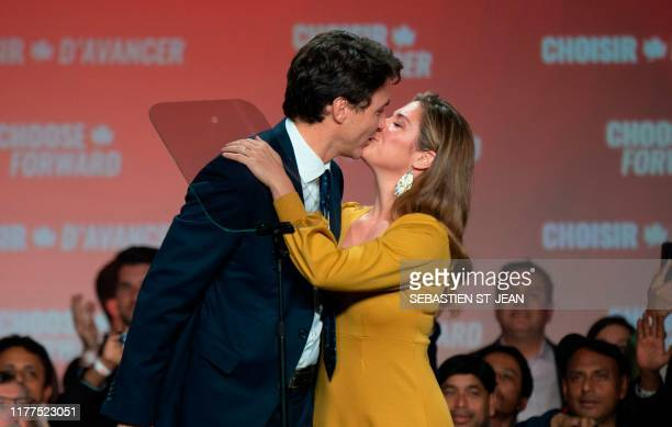 TOPSHOT Prime minister Justin Trudeau kisses his wife Sophie Grégoire Trudeau at the Palais des Congres in Montreal during Team Justin Trudeau 2019...