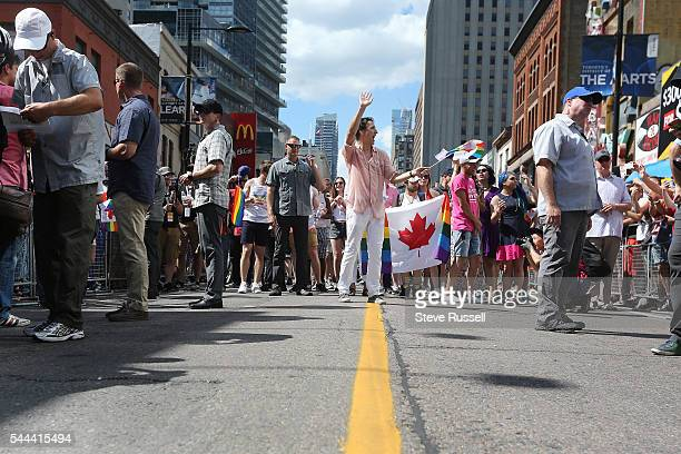 TORONTO ON JULY 3 Prime Minister Justin Trudeau marches during the the 2016 Toronto Pride parade along Yonge Street in Toronto July 3 2016