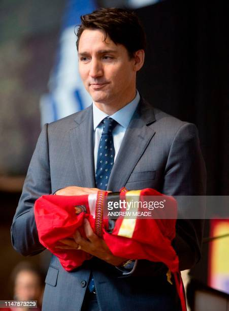 Prime Minister Justin Trudeau receives the signed copy of the National Inquiry into Missing and Murdered Indigenous Women and Girls at the closing...