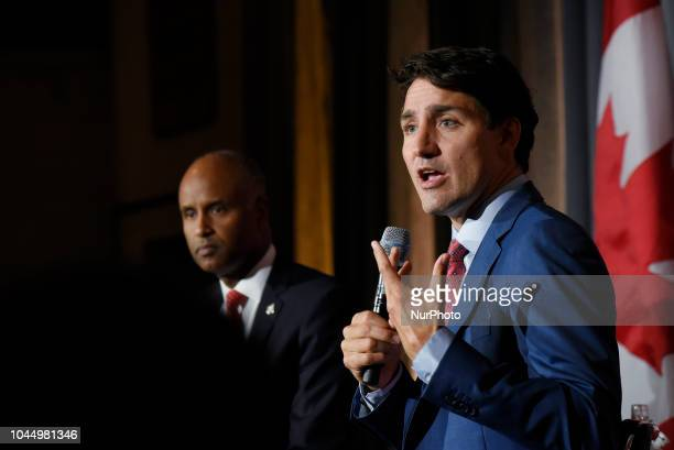 Prime Minister Justin Trudeau speaking while Ahmed Hussen the Minister of Immigration Refugees and Citizenship is listening during an armchair...