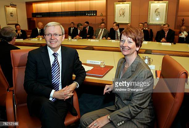 Prime Minister Kevin Rudd and deputy Prime Minister Julia Gillard pose at the government's first Ministers meeting in Parliament House on December 3...