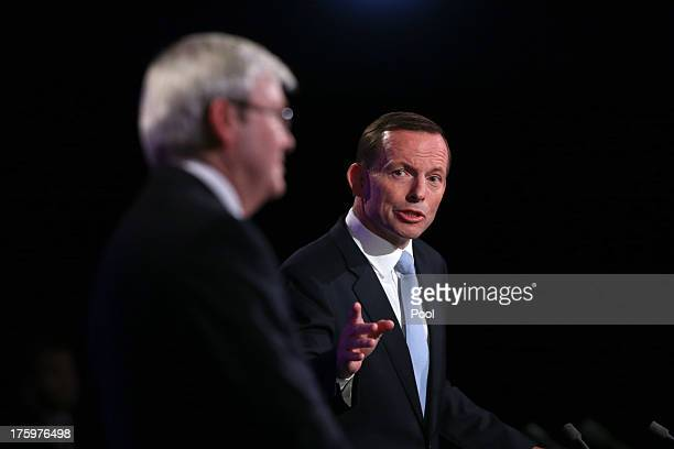 Prime Minister Kevin Rudd and Opposition Leader Tony Abbott during the Leaders Debate at the National Press Club on August 11, 2013 in Canberra,...
