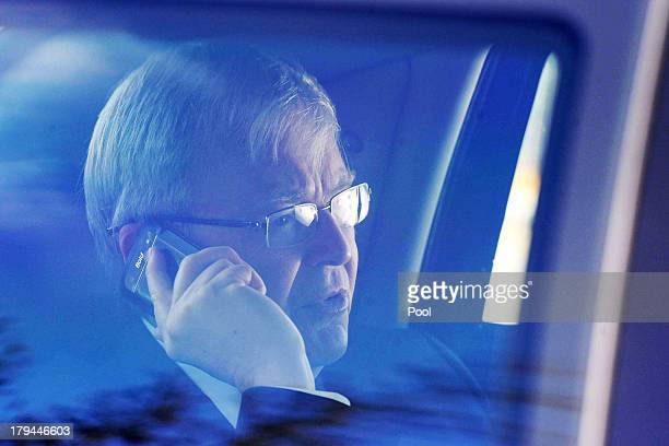 Prime Minister Kevin Rudd gestures after a phone interview with ABC Melbourne radio presenter Jon Faine on September 4, 2013 in Melbourne, Australia....