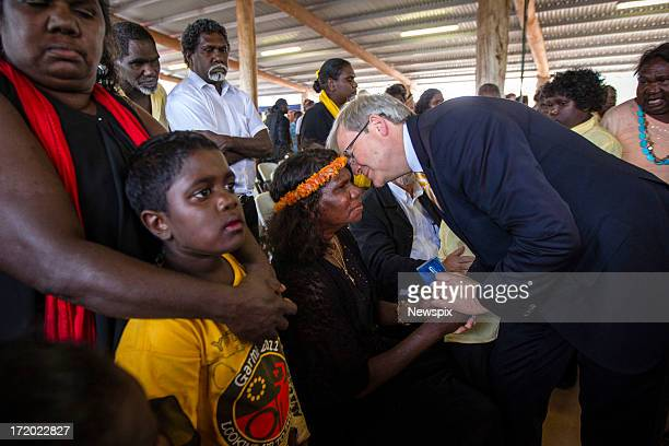 Prime Minister Kevin Rudd pays his respect to the widow of Mr Yunupingu, Yalmay Yunupingu during the state memorial service for 'Yothu Yindi' founder...