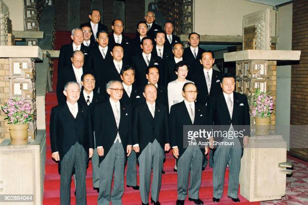 Prime Minister Kiichi Miyazawa and his cabinet members pose for photographs at the prime minister's official residence on December 12 1992 in Tokyo...