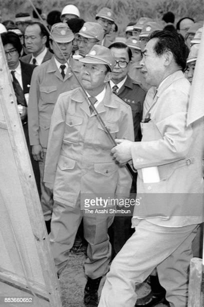 Prime Minister Kiichi Miyazawa listens to explanation as he inspects damage of Mount Unzen Pyroclastic Flow on March 14 1992 in Fukae Nagasaki Japan