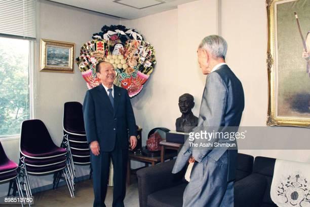 Prime Minister Kiichi Miyazawa meets former Prime Minister Takeo Fukuda on July 30 1992 in Tokyo Japan