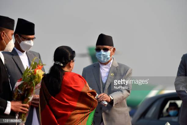 Prime Minister KP Sharma Oli along with face mask give flower bouquet to farewell President Bidya Devi Bhandari for two-day official state visit to...