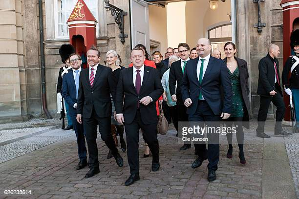 Prime Minister Lars Lokke Rasmussen with his new team of ministers meet the press outside Amalienborg after having presented his new coalition...