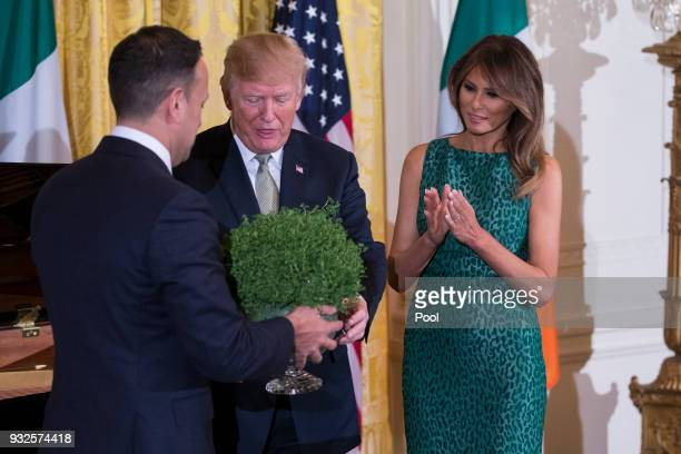 Prime Minister Leo Varadkar of Ireland presents United States President Donald J Trump and first lady Melania Trump with a bowl of shamrocks during...
