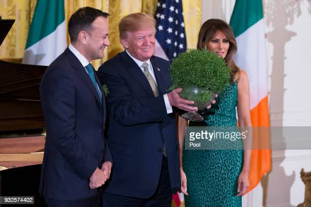 Prime Minister Leo Varadkar of Ireland United States President Donald J Trump and first lady Melania Trump pose with a bowl of shamrocks presented by...
