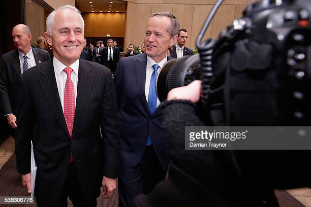 Prime Minister Malcolm Turnball and Opposition leader Bill Shorten walk through the media scrum after speaking at he RSL National Conference on June...