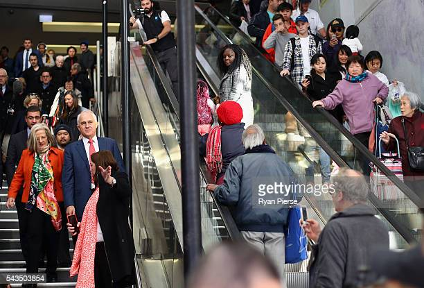 Prime Minister Malcolm Turnbull and his wife Lucy Turnbull arrive at Hurstville Station as he campaigns in Barton on June 29 2016 in Sydney Australia