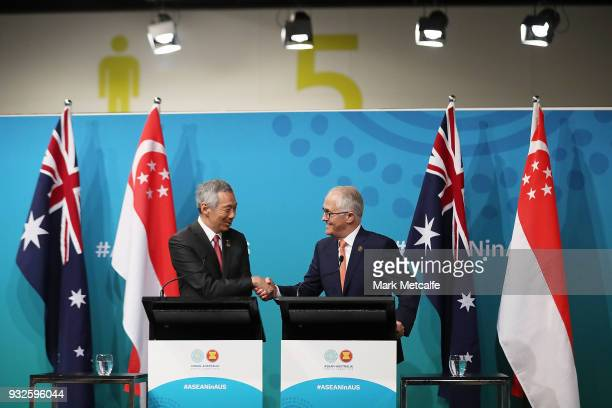 Prime Minister Malcolm Turnbull and Singapore Prime Minister Lee Hsien Loong shake hands at a Singapore Australia joint press conference on March 16...