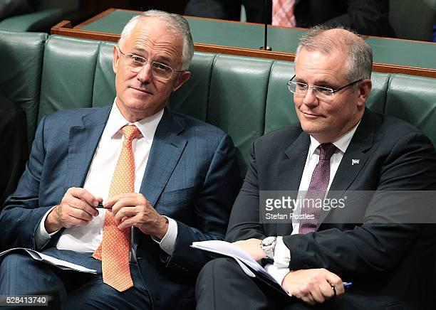 Prime Minister Malcolm Turnbull and Treasurer Scott Morrison listen to Opposition leader Bill Shorten deliver his budget reply speech on May 5 2016...