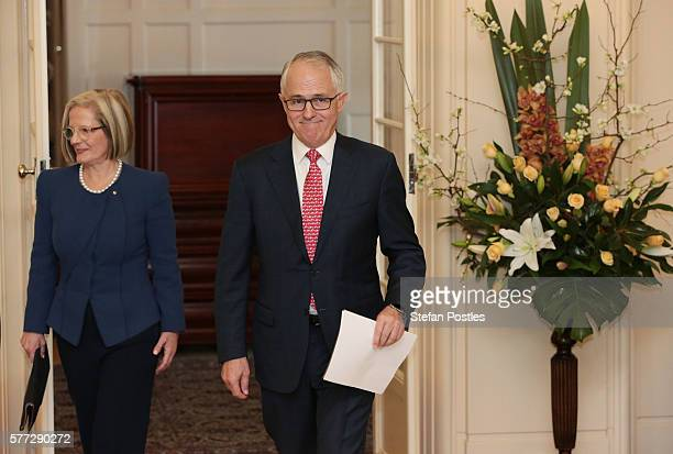 Prime Minister Malcolm Turnbull and wife Lucy Turnbull arrive at the swearingin ceremony at Government House on July 19 2016 in Canberra Australia...