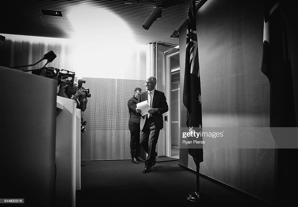This image was processed using digital filters) Prime Minister Malcolm Turnbull arrives for a press conference at the Commonwealth Parliament Offices on July 3, 2016 in Sydney, Australia. The prospect of a hung parliament looms as counting continues after election night on Saturday, with results too close with neither the Liberals nor Labor able to secure an absolute majority victory.