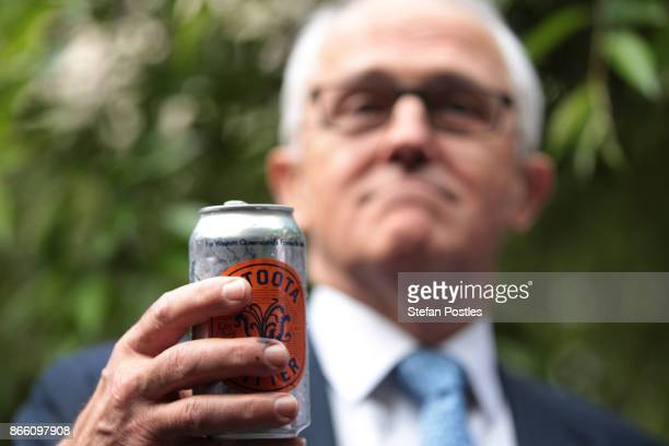 Prime Minister Malcolm Turnbull drinks a Betoota Bitter at the launch of the Betoota Advocate's book 'Betoota's Australia' at Parliament House on...