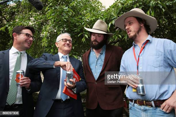 Prime Minister Malcolm Turnbull drinks with Betoota Advocate founders Clancy Overell and Errol Parker at the launch of the Betoota Advocate's book...