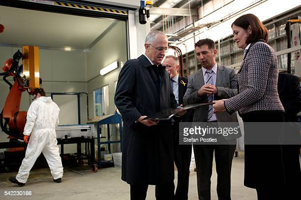 Prime Minister Malcolm Turnbull inspects carbon fibre products at Quickstep Technologies an advanced composite manufacturer on June 23 2016 in...