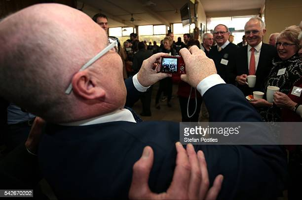 Prime Minister Malcolm Turnbull is photographed with members of the public by Liberal Member for Braddon Brett Whiteley at the Devonport Golf Club on...