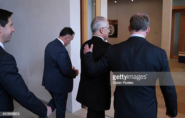 Prime Minister Malcolm Turnbull leaves a doorstop with the Premier of Tasmania Will Hodgman during a visit to Design Centre Tasmania on June 24 2016...